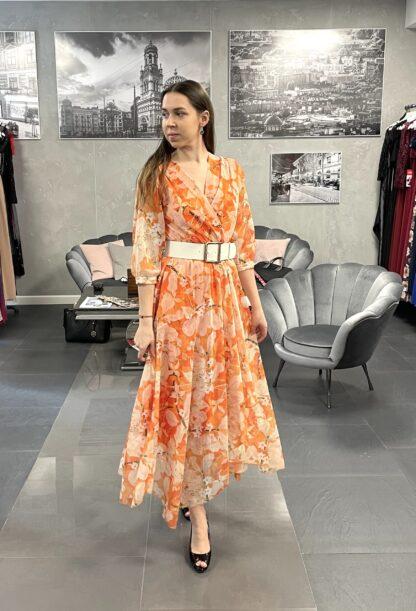pomarańczowa sukienka w kwiaty